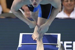 Jack Conger dives at the start of his heat in the men's 100-meter butterfly semifinals at the U.S. Olympic swimming trials, Friday, July 1, 2016, in Omaha, Neb. (AP Photo/Mark J. Terrill)
