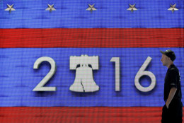 A worker walks past a video display during preparations for the 2016 Democratic National Convention, Friday, July 22, 2016, in Philadelphia. As Cleveland breathes a sigh of relief after protests during the Republican convention came and went without major chaos, eyes now turn to Philadelphia.(AP Photo/Matt Slocum)