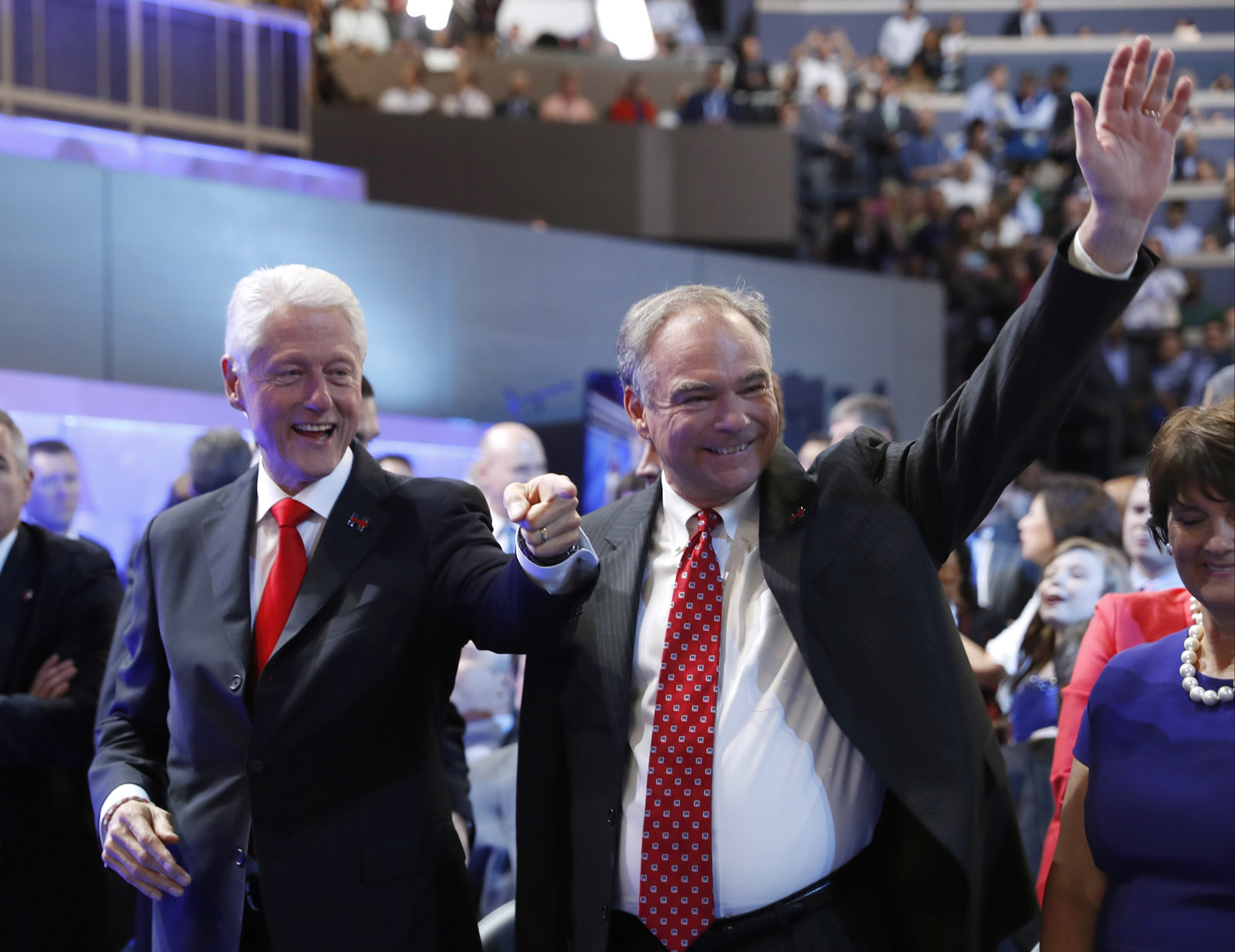 Former President Bill Clinton and Democratic vice presidential candidate, Sen. Tim Kaine, D-Va., arrive on the convention floor before Democratic presidential nominee Hillary Clinton speaks during the final day of the Democratic National Convention in Philadelphia, Thursday, July 28, 2016. (AP Photo/Carolyn Kaster)