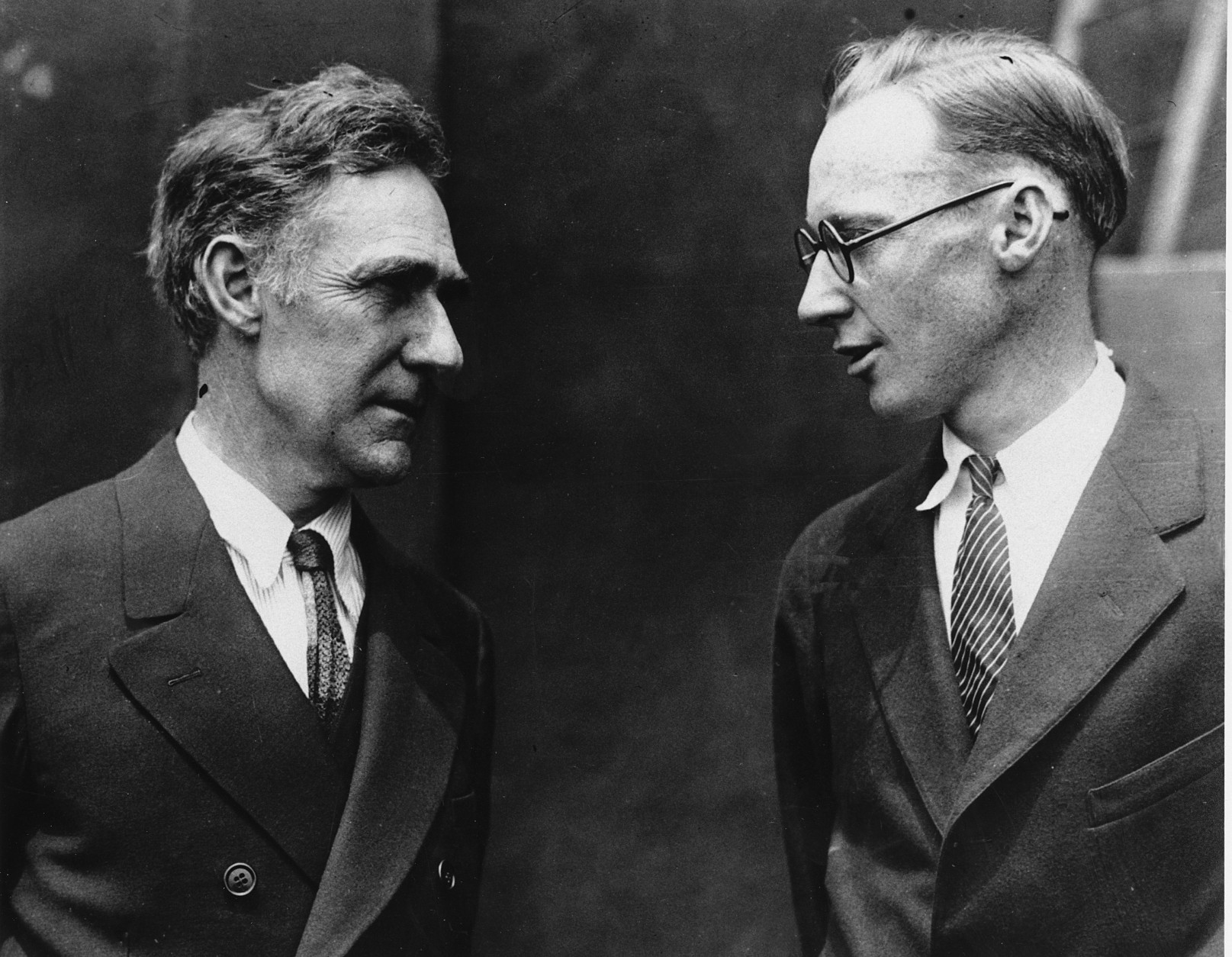 This is a 1925 photo of John T. Scopes, right, conferring with his attorney John R. Kia in Dayton, Tenn.  (AP Photo)