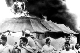This was the scene of pandemonium at Hartford, Conn., on July 6, 1944, when a fire in which over 145 persons died, struck the tented Ringling Bros. Barnum and Bailey Circus.  On July 16, the circus folded its mammoth tent for the last time after a performance at Pittsburgh, Pa., and then appeared in 1957 in indoor arenas.  Labor troubles, bad weather, and rising costs sounded the death knell for the circus tour which thrilled millions of youngsters and grownups.  (AP Photo)
