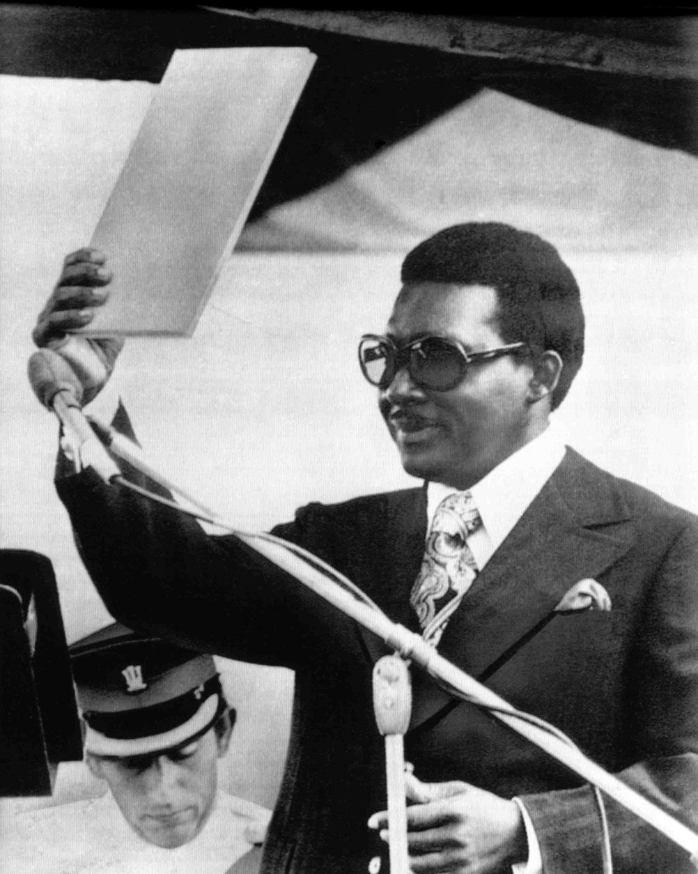 Bahamas Prime Minister Lynden O. Pindling holds the constitutional papers symbolizing freedom from three centuries of British Colonial rule during ceremonies marking his nation's first day as an independent state, in Nassau, on July 10, 1973. Pindling received the papers from Britain's Prince Charles, seen lower left. (AP Photo)