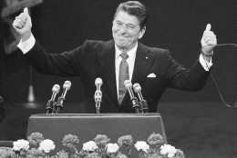 FILE - In this July 17, 1980, file photo, Republican presidential candidate Ronald Reagan stands before a cheering Republican National Convention in Detroit's Joe Louis Arena. Republicans heading to their 2012 party convention in Tampa are eager to hear an earful about the shortcomings of President Barack Obama's record, the woeful U.S. economy and the competing visions of the two presidential candidates. They aren't looking for compromise, which most Americans say is necessary to get the nation on track. The delegates hear rhetoric that is brutal, vitriolic and far from conciliatory. The Republicans want a party like in 1980 when the GOP ousted a Democratic president after one term. (AP Photo/Rusty Kennedy, File)