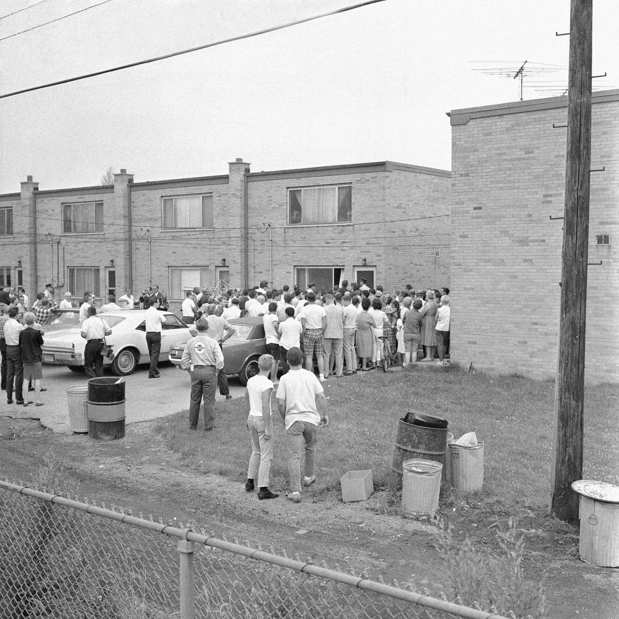 Scene outside the town house dormitory on Chicago's South Side, July 14, 1966 where eight student nurses were found slain. (AP Photo)