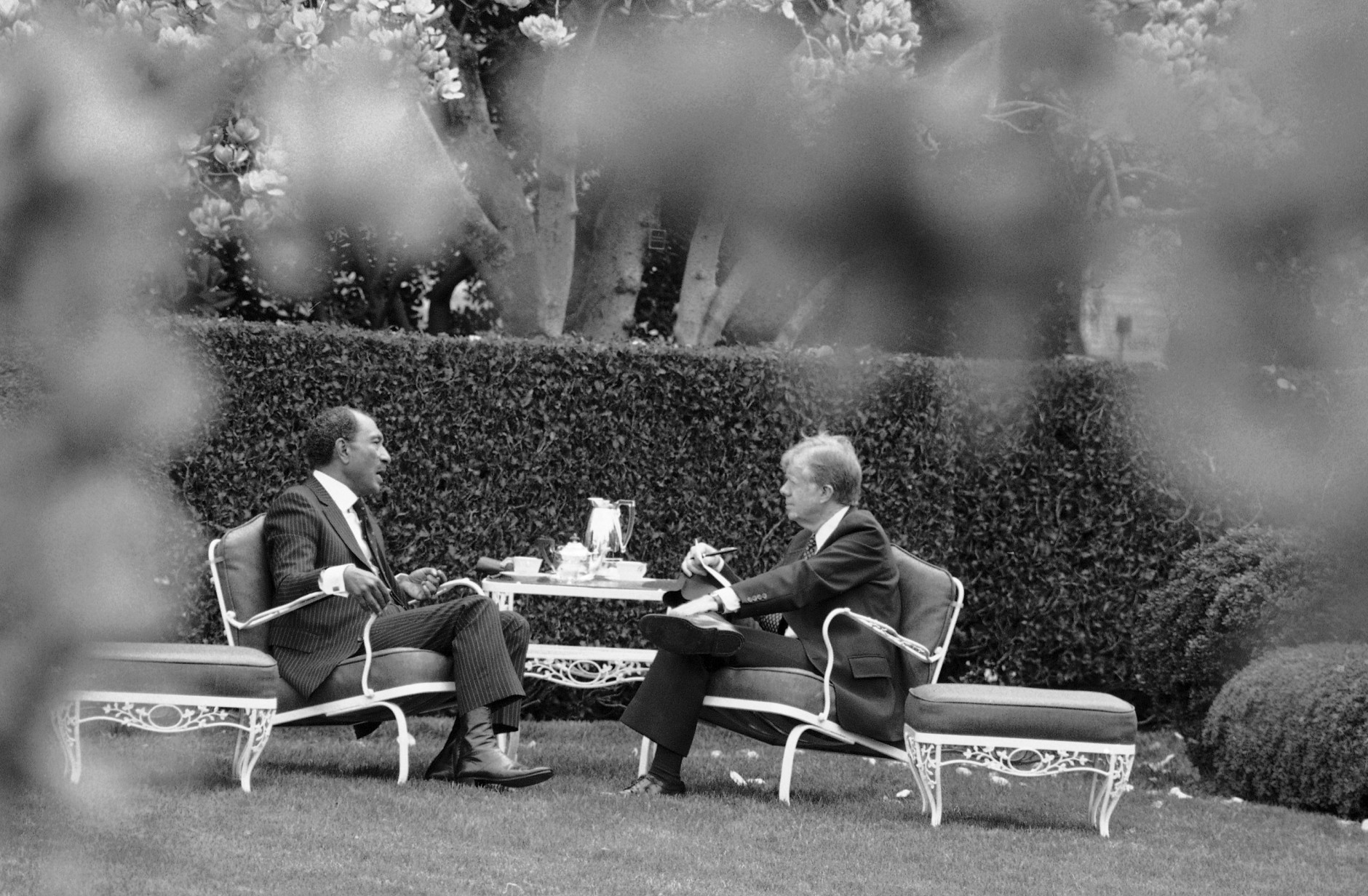 Egyptian President Anwar Sadat, left, and President Jimmy Carter have a lunch in the Rose Garden of the White House in Washington on April 8, 1980. Sadat is meeting with Carter trying to break through the stalled peace talks with Israel. (AP Photo)
