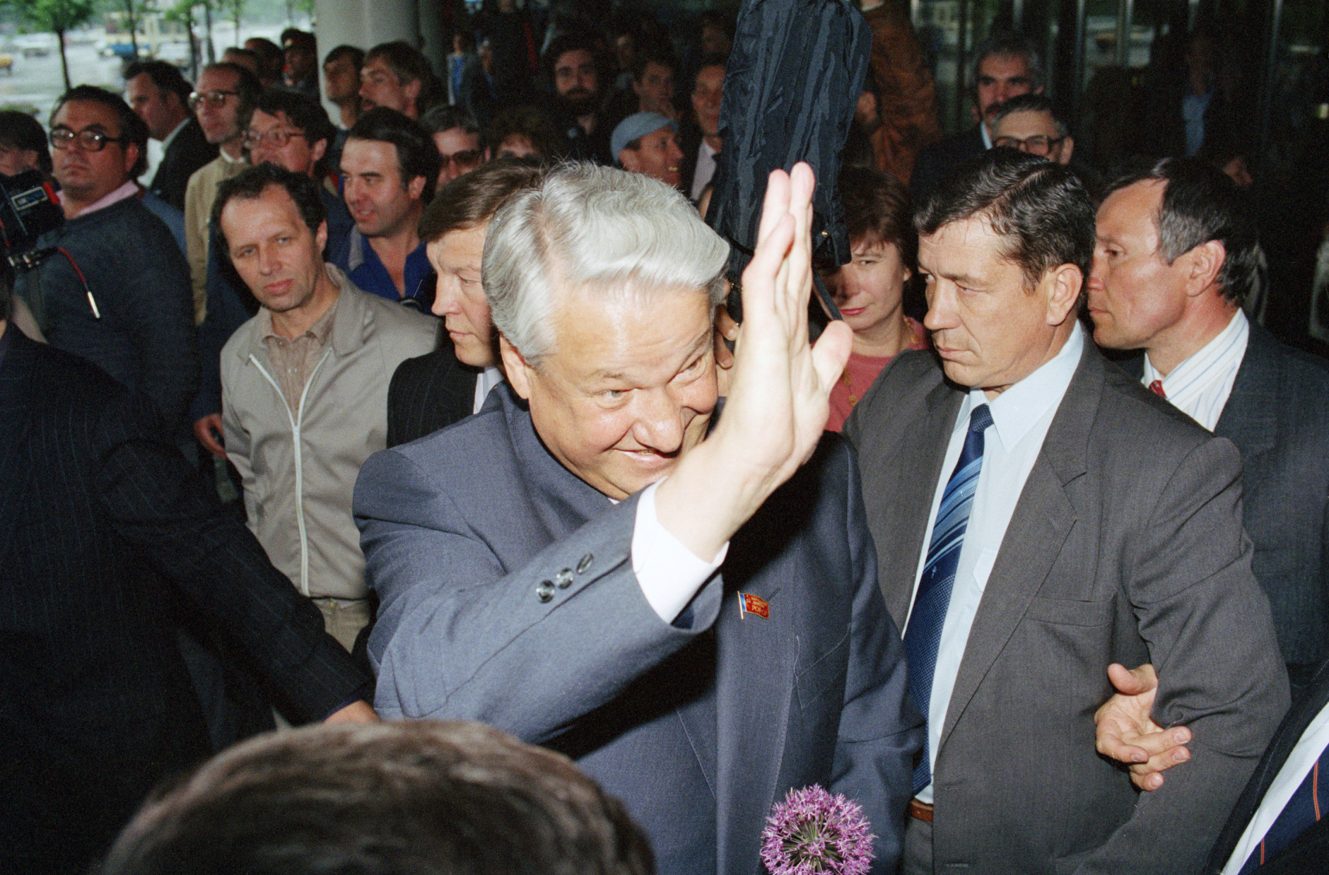 Russian leader and presidential candidate Boris Yeltsin waves to supporters after a campaign speech in Moscow, Saturday, June 1, 1991. During his speech, Yeltsin promised to meet with church officials to negotiate the return of church land confiscated by the communist party. (AP Photo/Alexander Zemlianichenko)