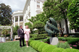 Hillary Rodham Clinton, accompanied by Towsend Wolfe, director and chief curator for the Arkansas Arts Center in Little Rock, unveiled the latest sculptures to grace the First Lady's Garden on May 15, 1995.  Displayed at right is 'Vertical Void' by Carol Hepper.  (AP Photo/Charles Tasnadi)
