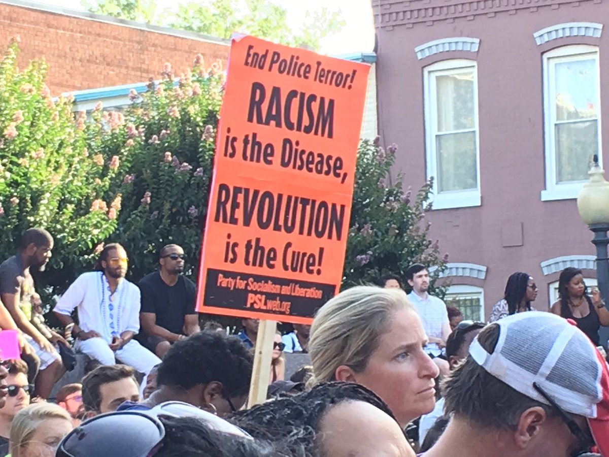 The scene at a prayer vigil at the African American Civil War Memorial and Museum in D.C. on Sunday, July 10, 2016. (WTOP/Liz Anderson)