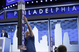 Jimmy Wright installs the New York delegation placard ahead of the 2016 Democratic National Convention in Philadelphia, Sunday, July 24, 2016. (AP Photo/Matt Rourke)