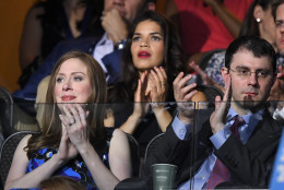 Chelsea Clinton, daughter of Democratic Presidential candidate Hillary Clinton, left, applauds alongside her husband Marc Mezvinsky during the second day of the Democratic National Convention in Philadelphia , Tuesday, July 26, 2016. (AP Photo/Mark J. Terrill)