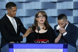 "Christine Leinonen, the mother of Christopher ""Drew"" Leinonen, who was killed in the nightclub attack in Orlando, is joined on stage by Brandon Wolf, survivor of the nightclub attack in Orlando., and Jose Arraigada, survivor of the nightclub attack in Orlando., as she speaks during the third day of the Democratic National Convention in Philadelphia , Wednesday, July 27, 2016. (AP Photo/J. Scott Applewhite)"