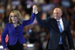 Former Rep. Gabby Giffords, D-Ariz, and her husband Astronaut Mark Kelly (Ret.), exit the stage after speaking during the third day of the Democratic National Convention in Philadelphia , Wednesday, July 27, 2016. (AP Photo/Paul Sancya)