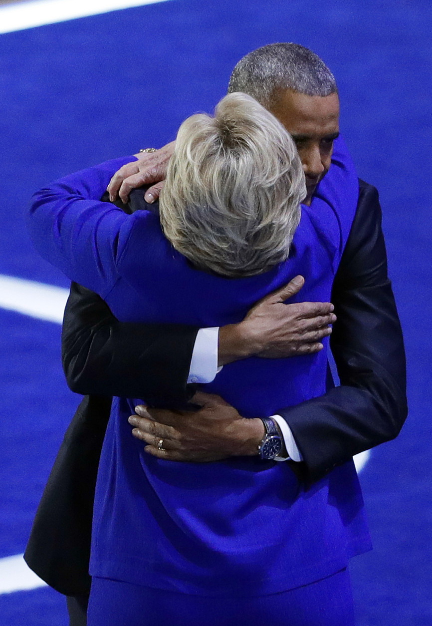 President Barack Obama embraces Democratic presidential candidate Hillary Clinton during the third day of the Democratic National Convention, Wednesday, July 27, 2016, in Philadelphia. (AP Photo/John Locher)