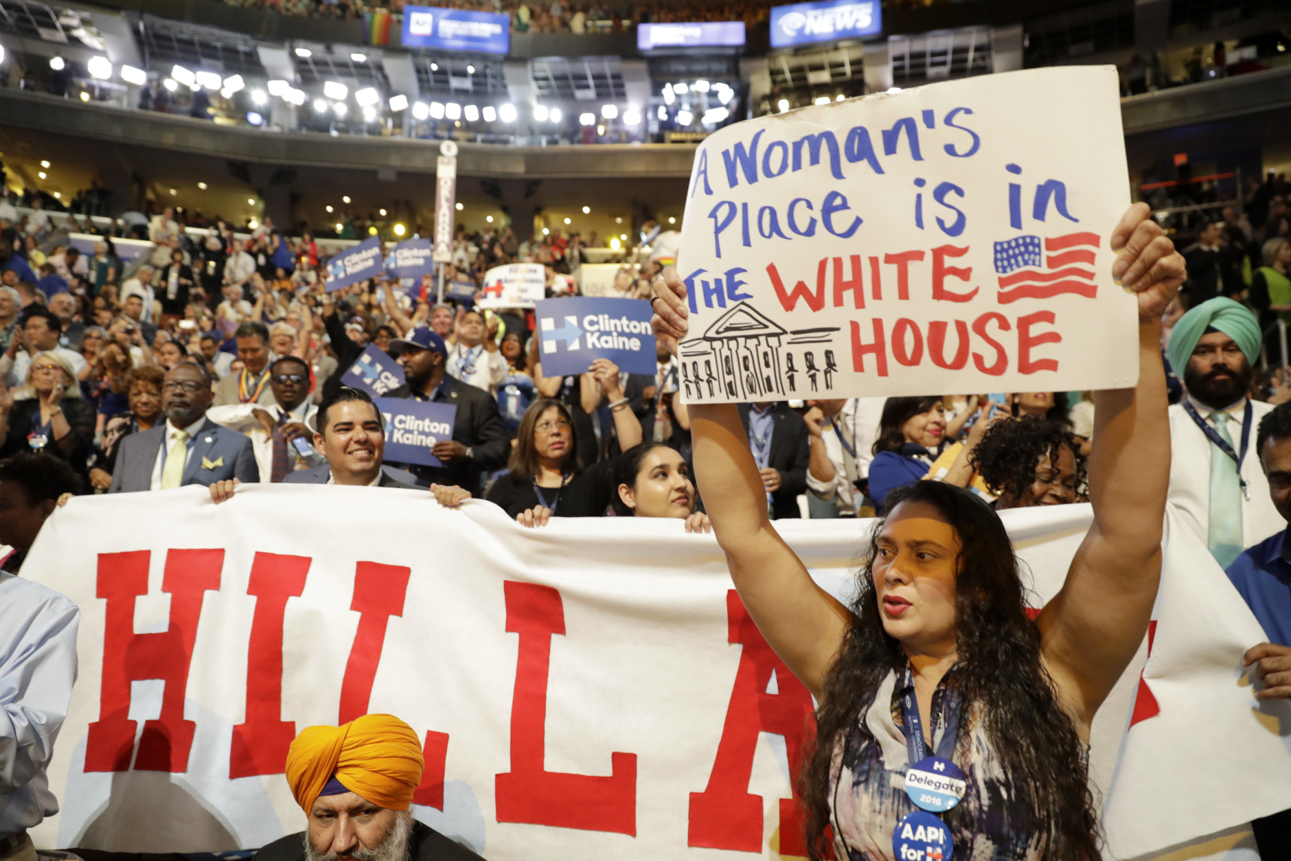 California delegates hold up signs as they cheer for Democratic presidential nominee Hillary Clinton during the final day of the Democratic National Convention in Philadelphia, Thursday, July 28, 2016. (AP Photo/Matt Rourke)