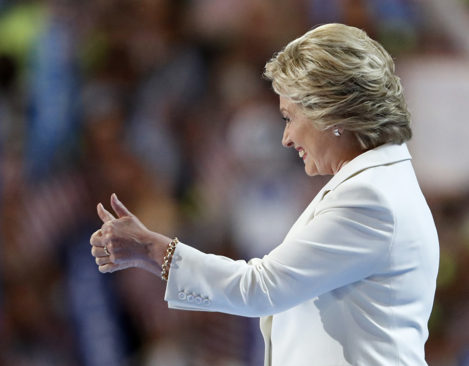 Democratic presidential nominee Hillary Clinton gives a thumbs up on stage during the final day of the Democratic National Convention in Philadelphia , Thursday, July 28, 2016. (AP Photo/Paul Sancya)