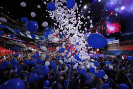 Balloons descend at the Wells Fargo Center after Democratic presidential nominee Hillary Clinton's acceptance speech during the final day of the Democratic National Convention in Philadelphia , Thursday, July 28, 2016. (AP Photo/Paul Sancya)