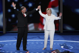 Democratic vice presidential nominee Sen. Tim Kaine, D-Va., and Democratic presidential nominee Hillary Clinton waves to delegates during the final day of the Democratic National Convention in Philadelphia , Thursday, July 28, 2016. (AP Photo/J. Scott Applewhite)