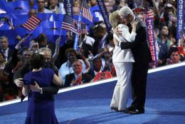 Former President Bill Clinton, right, hugs Democratic presidential nominee Hillary Clinton as Democratic vice presidential nominee Sen. Tim Kaine, D-Va., hugs his wife wife Anne Holton during the final day of the Democratic National Convention, Thursday, July 28, 2016, in Philadelphia. (AP Photo/John Locher)