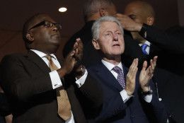Former President Bill Clinton applauds as First Lady Michelle Obama speaks during the first day of the Democratic National Convention in Philadelphia , Monday, July 25, 2016. (AP Photo/J. Scott Applewhite)