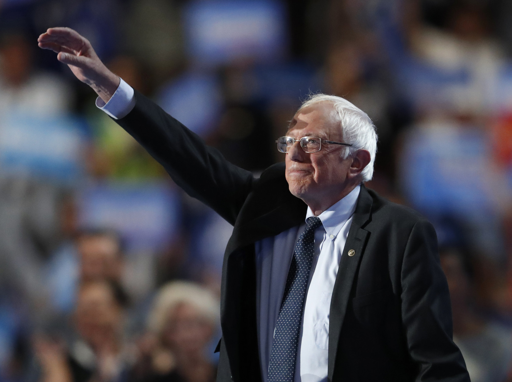 Former Democratic Presidential candidate, Sen. Bernie Sanders, I-Vt., takes the stage during the first day of the Democratic National Convention in Philadelphia , Monday, July 25, 2016. (AP Photo/Paul Sancya)