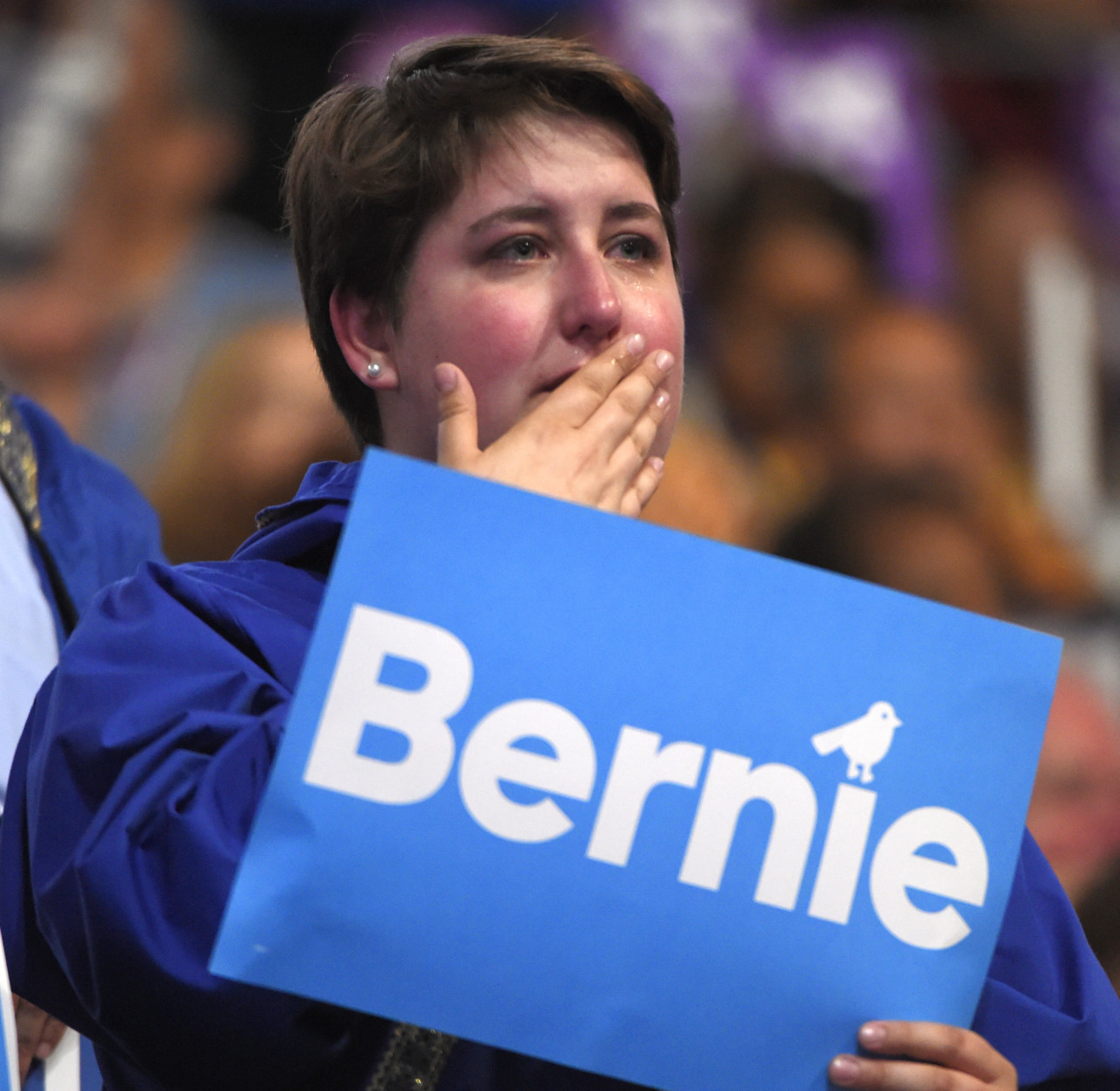 A supporter cries while listening to Former Democratic Presidential candidate, Sen. Bernie Sanders, I-Vt., speak during the first day of the Democratic National Convention in Philadelphia , Monday, July 25, 2016. (AP Photo/=2015338Name=)