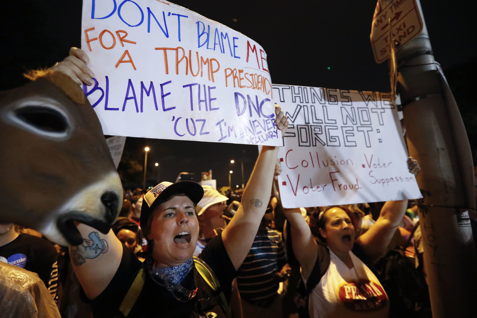 Demonstrators yell during protest at Franklin Delano Roosevelt park in Philadelphia, Thursday, July 28, 2016, during the final day of the Democratic National Convention. (AP Photo/Alex Brandon)
