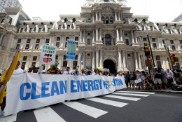 Environmental protesters march in front of City Hall on Sunday, July 24, 2016, in Philadelphia. The Democratic National Convention starts Monday in Philadelphia. (AP Photo/Alex Brandon)