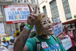 A supporter of Sen. Bernie Sanders, I-Vt., marches during a protest in downtown on Sunday, July 24, 2016, in Philadelphia. The Democratic National Convention starts Monday in Philadelphia. (AP Photo/John Minchillo)