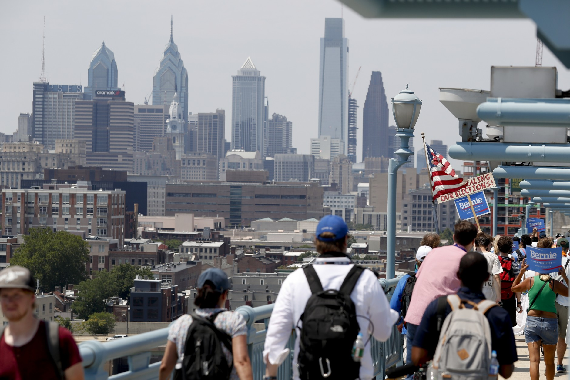 Demonstrators make their way to downtown on the Benjamin Franklin Bridge Monday, July 25, 2016, in Philadelphia, during the first day of the Democratic National Convention. (AP Photo/Alex Brandon)