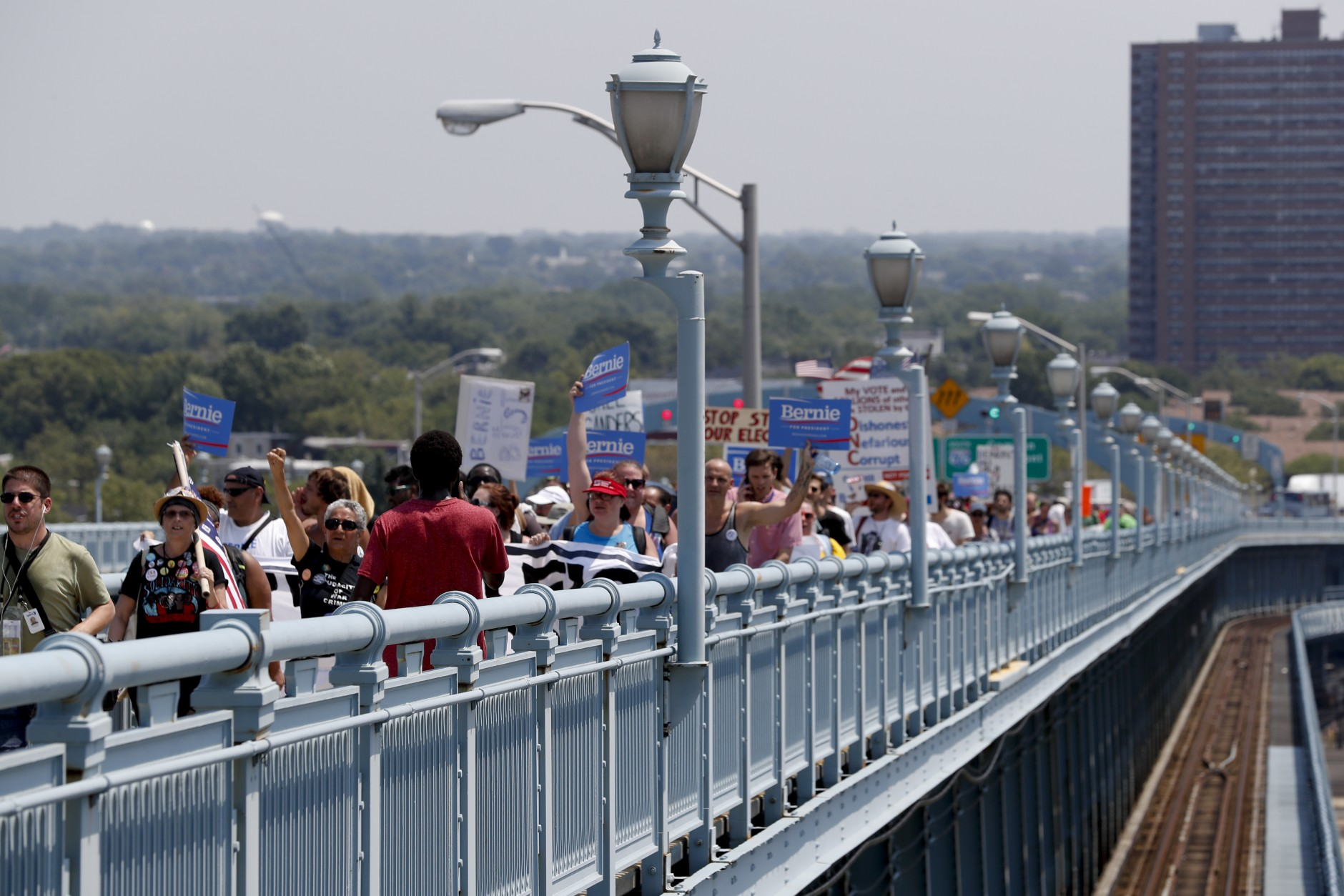 Demonstrators make their way to downtown Philadelphia on the Benjamin Franklin Bridge near Camden, N.J. on Monday, July 25, 2016, during the first day of the Democratic National Convention. (AP Photo/Alex Brandon)