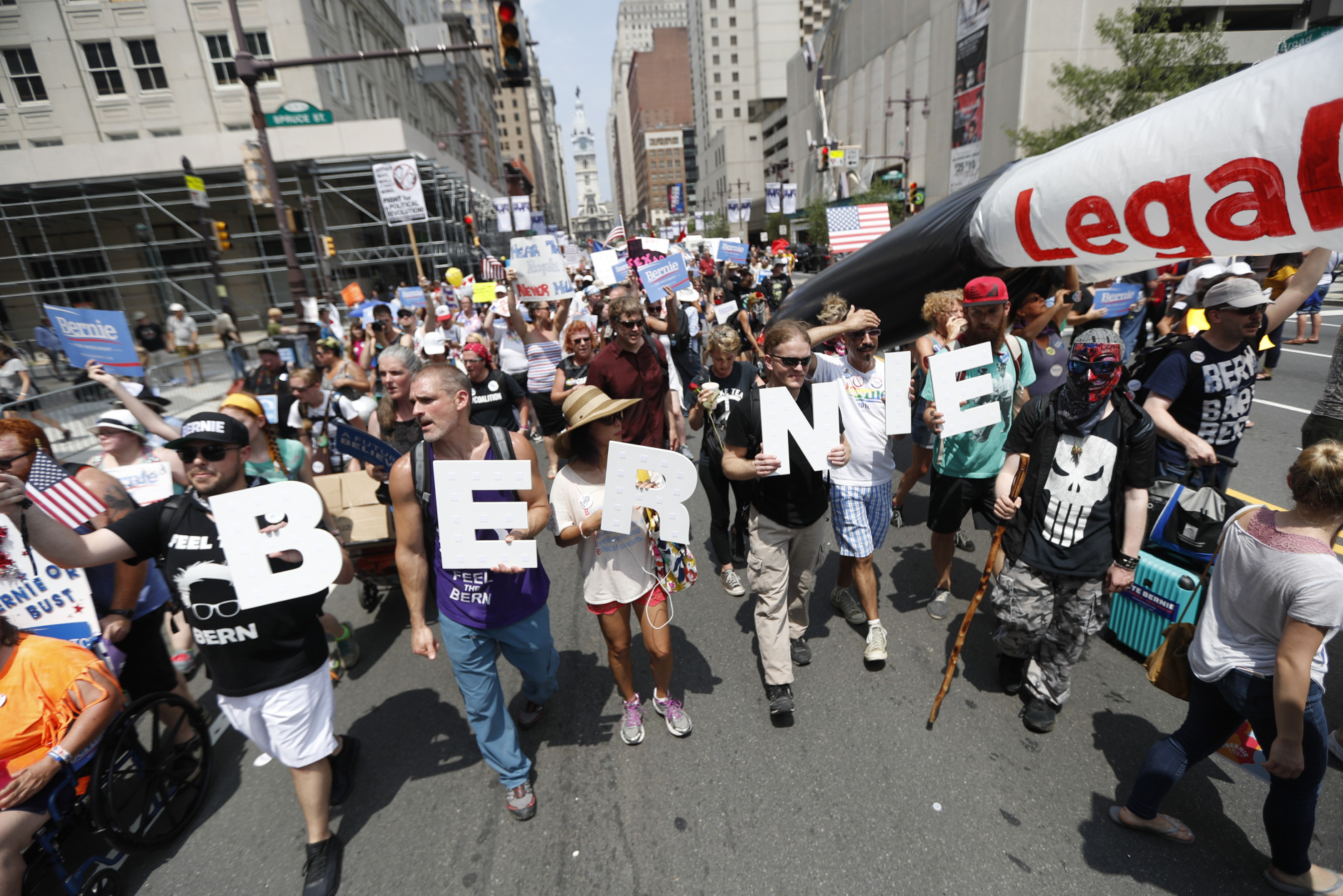 Supporters of Sen. Bernie Sanders, I-Vt., march during a protest in downtown on, Monday, July 25, 2016, in Philadelphia, during the first day of the Democratic National Convention. (AP Photo/John Minchillo)