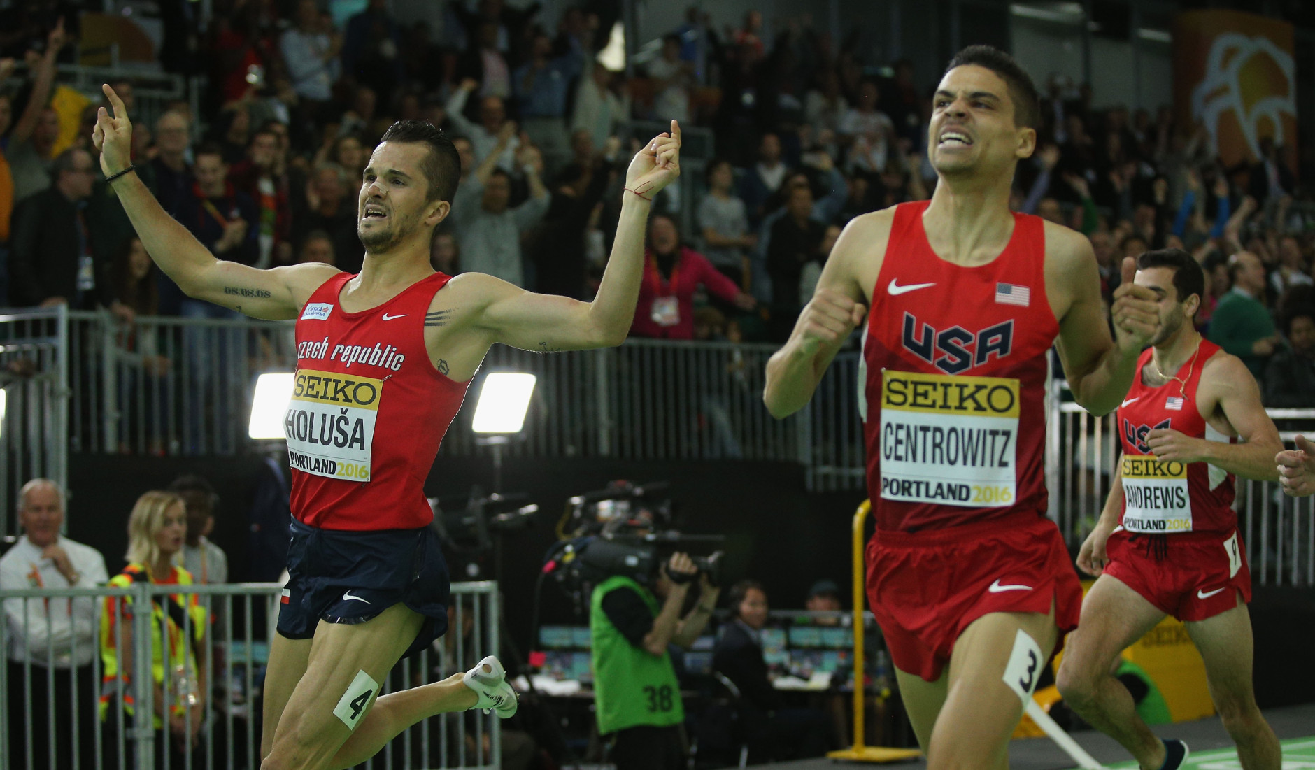 PORTLAND, OR - MARCH 20:  Matthew Centrowitz of the United States (C) crosses the line to win gold ahead of Jakub Holusa of the Czech Republic (L) in the Men's 1500 Metres Final during day four of the IAAF World Indoor Championships at Oregon Convention Center on March 20, 2016 in Portland, Oregon.  (Photo by Ian Walton/Getty Images for IAAF)