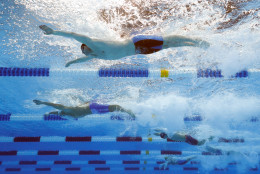 OMAHA, NE - JULY 01:  Jack Conger, Matthew Josa and Michael Andrew of the United States compete in a heat for the Men's 100 Meter Butterfly during Day Six of the 2016 U.S. Olympic Team Swimming Trials at CenturyLink Center on July 1, 2016 in Omaha, Nebraska.  (Photo by Tom Pennington/Getty Images)