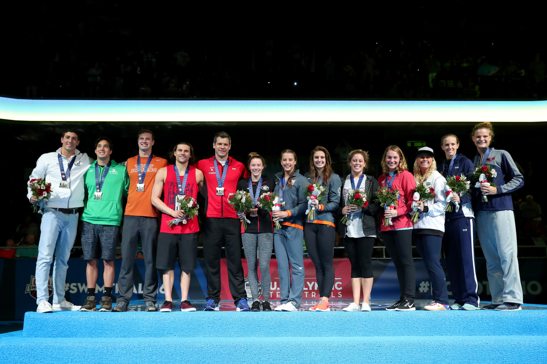 (L-R) Jacob Pebley, Jay Litherland, Jack Conger, Cody Miller, David Plummer, Hali Flickinger, Katie Baker, Katie Meili, Molly Hannis, Melanie Margalis, Elizabeth Beisel, Dana Vollmer and Sierra Ranger of the United States participate in the medal ceremony for the Olympic Team Qualifiers during Day Seven of the 2016 U.S. Olympic Team Swimming Trials at CenturyLink Center on July 2, 2016 in Omaha, Nebraska.  (Photo by Tom Pennington/Getty Images)