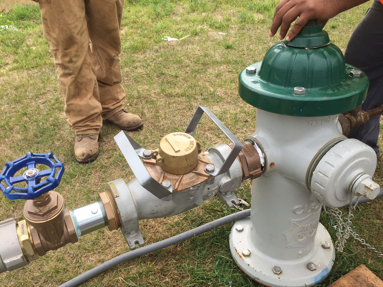 Presence of a water meter indicates a person filing a water truck from a hydrant is doing it legally. (WTOP/Neal Augenstein)