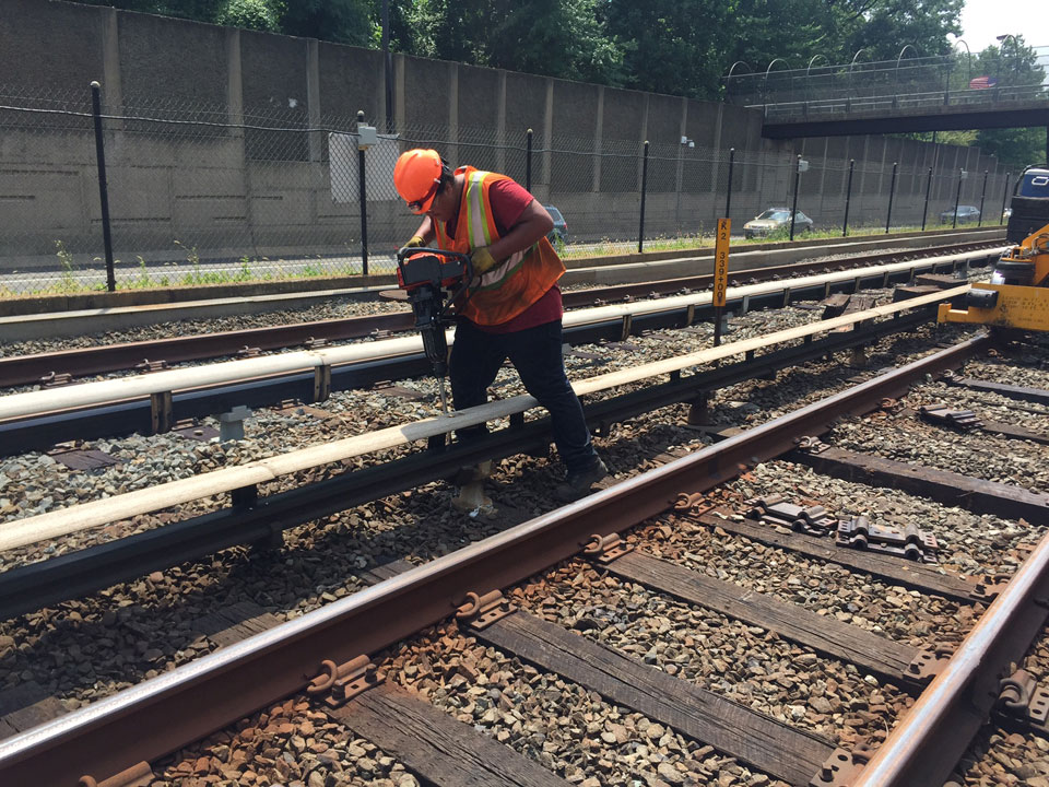A Metro worker is seen doing repairs during summer 2016's 24/7 trackwork program. (WTOP/Max Smith)