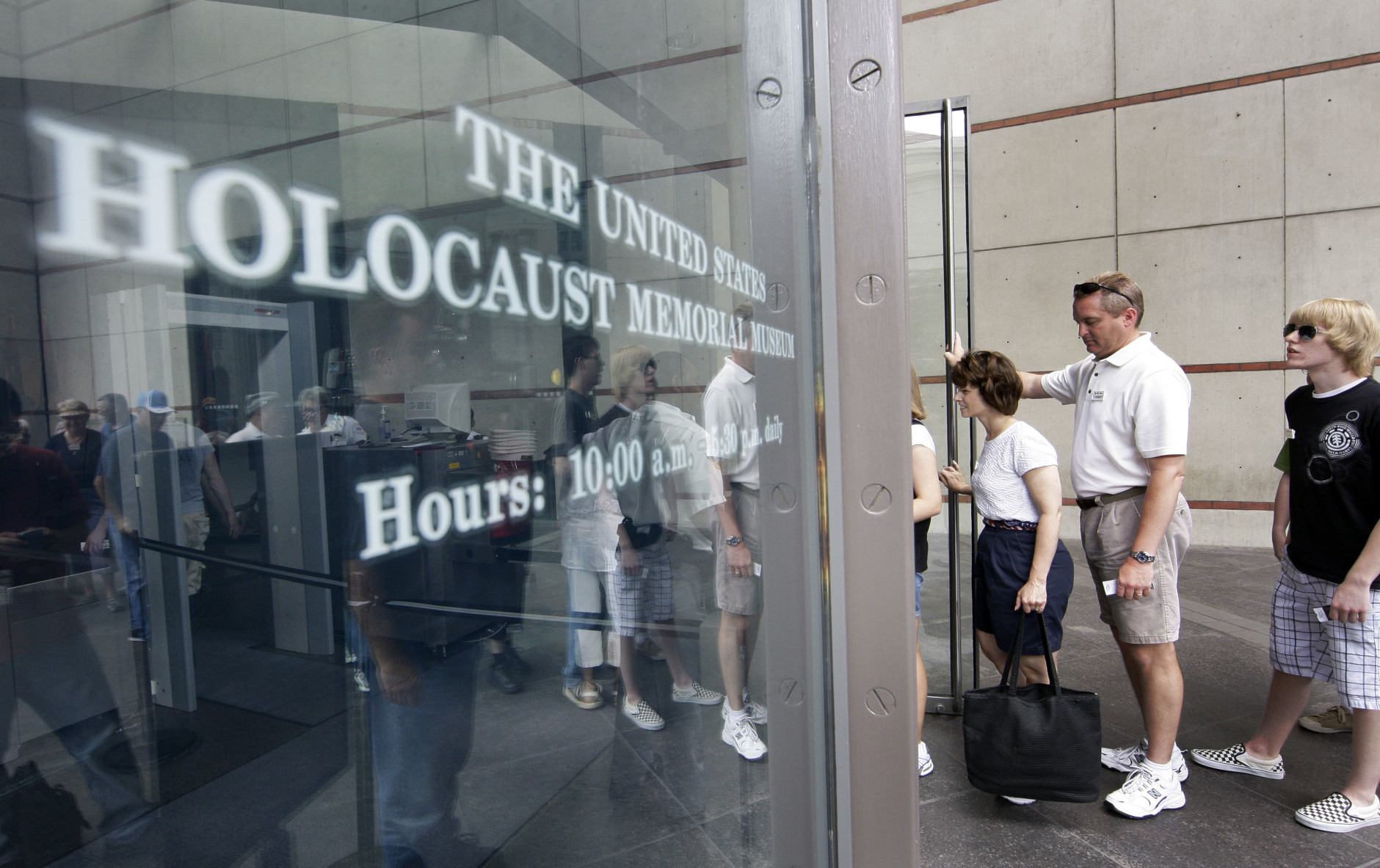 """FILE - In this June 12, 2009 file photo, people line to enter the U.S. Holocaust Memorial Museum in Washington.  The U.S. museum is requesting that smartphone users refrain from """"catching"""" Pokemon when they are inside the museum. Museum Communications Director Andrew Hollinger tells The Washington Post that officials are trying to reach game developers to get the museum removed as a prominent location in the popular new Pokemon Go smartphone game.  (AP Photo/Alex Brandon, File)"""