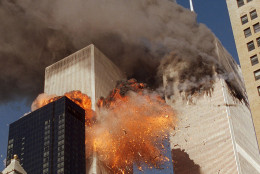 """FILE- In this Sept. 11, 2001 file photo, smoke billows from World Trade Center Tower 1 and flames explode from Tower 2 as it is struck by American Airlines Flight 175, in New York. The government is preparing to release a once-classified chapter of a congressional report about the attacks of Sept. 11, that questions whether Saudi nationals who helped the hijackers with things like finding apartments and opening bank accounts knew what they were planning. House Minority Leader Nancy Pelosi said Friday July 15, 2016, that the release of the 28-page chapter is """"imminent."""" (AP Photo/Chao Soi Cheong, File) MANDATORY CREDIT"""