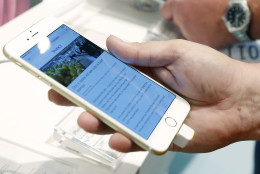 Kids could earn cash by not being on their phones. (AP Photo/Rogelio V. Solis, File)
