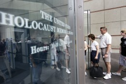 """FILE - In this June 12, 2009, file photo, people stand in line to enter the U.S. Holocaust Memorial Museum in Washington. The U.S. museum is requesting that smartphone users refrain from """"catching"""" Pokemon when they are inside the museum. Museum Communications Director Andrew Hollinger tells The Washington Post that officials are trying to reach game developers to get the museum removed as a prominent location in the popular new """"Pokemon Go"""" smartphone game. (AP Photo/Alex Brandon, File)"""