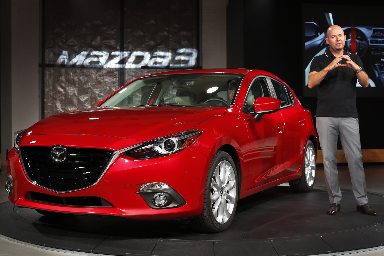 IMAGE DISTRIBUTED FOR MAZDA - Derek Jenkins, Director of Design for Mazda North America, introduces the new Mazda 3 at the Mazda Unveil & Press Event on Wednesday, June 26, 2013 in New York. (John Minchillo/AP Images for Mazda)