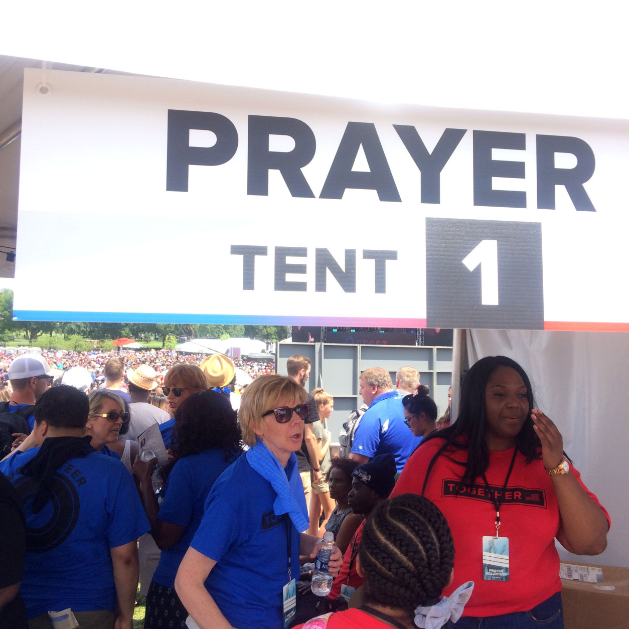 Staff work at a prayer tent during the Together 2016 event Saturday, July 16, 2016. (WTOP/Dick Uliano)