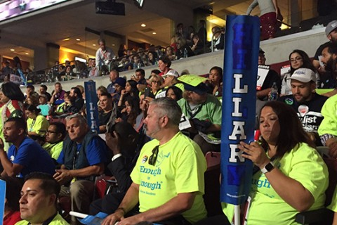 Delegates hold up 'liar' signs and chant 'no more war' during DNC