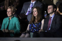 Chelsea Clinton, daughter of Democratic Presidential candidate Hillary Clinton, left, watches alongside her husband Marc Mezvinsky as her father speaks during the second day session of the Democratic National Convention in Philadelphia, Tuesday, July 26, 2016. At left is Sen. Elizabeth Warren, D-Mass. (AP Photo/Matt Rourke)