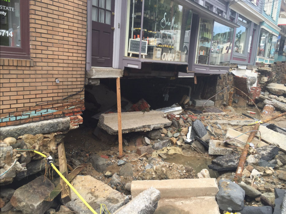 Flooding is seen in Ellicott City ravaged through Main Street Saturday, July 30, 2016. (WTOP/Dennis Foley)