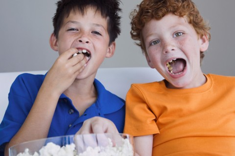 Study: Kids eat extra calories after commercials for 'unhealthy' foods