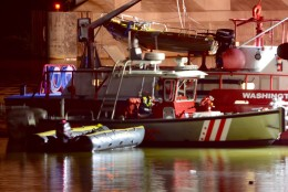 D.C. Fire and EMS have recovered the car that crashed into the Potomac River near Roosevelt Bridge late Saturday evening. (WTOP/Dave Dildine)