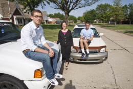 In this May 17, 2011 photo, David Helm, left, Molly Helm, center, and Harrison Maud pose with the boys' automobiles in Enid, Okla. As every driver quickly learns, operating costs are just the beginning. Add in ownership costs like insurance and registration fees and the costs quickly climb _ to an average $8,776 per year, or 58.5 cents per mile, for a car driven 15,000 miles annually.(AP Photo/Sue Ogrocki)