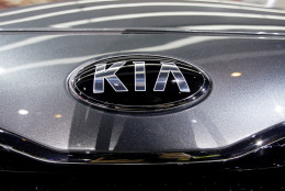 Kia's 2014 Forte5-Door car is revealed during the media preview of the Chicago Auto Show at McCormick Place in Chicago on Thursday, Feb. 7, 2013. (AP photo/Nam Y. Huh)
