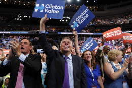 Virginia Gov. Terry McAuliffe and other delegates cheer as Democratic vice presidential candidate, Sen. Tim Kaine, D-Va., speaks during the third day session of the Democratic National Convention in Philadelphia, Wednesday, July 27, 2016. (AP Photo/Carolyn Kaster)
